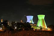 Israel, Haifa bay, The oil refinery, night shot of the vividly illuminated flues .