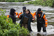 HS2 security guards push a female anti-HS2 activist in the river Colne at Denham Ford during bridge building works for the HS2 high-speed rail link on the first day of the second national coronavirus lockdown on 5 November 2020 in Denham, United Kingdom. Prime Minister Boris Johnson has advised that construction work may continue during the second lockdown but those working on construction projects are required to adhere to Site Operating Procedures including social distancing guidelines to help prevent the spread of COVID-19.