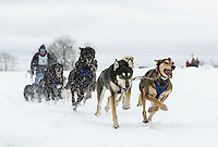 Claude Bellerive and his team head out on the 15 mile course for the Open Class series Friday afternoon during the 84th annual Laconia World Championship Sled Dog Races. (Karen Bobotas/for the Laconia Daily Sun)