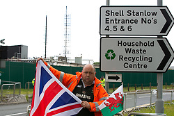 © licensed to London News Pictures. Ellesmere Port, UK 08/05/2011. Fuel protest organiser, Ian Charlesworth, outside Stanlow Oil Refinery today (8th May). Fuel protesters are due to blockade the Stanlow Oil Refinery at Ellesmere Port, Cheshire. Organiser, Ian Charlesworth says that a 24 pence discount off the price of a litre of petrol is required to bring the UK in line with average European pricing and to keep British businesses competitive. He says he is expecting more than 1000 vehicles to turn up and is expecting to stay for at least a week. Please see special instructions for usage rates. Photo credit should read Joel Goodman/LNP