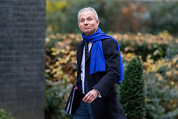 © Licensed to London News Pictures. 05/12/2017. London, UK. Justice Secretary and Lord Chancellor David Lidington arriving in Downing Street to attend a Cabinet meeting this morning.Yesterday, Brexit negotiations on the Northern Ireland border were stalled when Arlene Foster of the DUP said she could not support commitment to keep Northern Ireland aligned with EU laws. Photo credit : Tom Nicholson/LNP