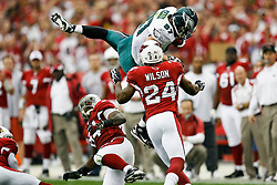 18 Jan 2009: Philadelphia Eagles tight end Brent Celek #87 runs the ball and gets a few extra yards by jumping over Arizona Cardinals linebacker Gerald Hayes #54 during the NFC Championship game against the Arizona Cardinals on January 18th, 2009. The Cardinals won 32-25 at University of Phoenix Stadium in Glendale, Arizona. (Photo by Brian Garfinkel)