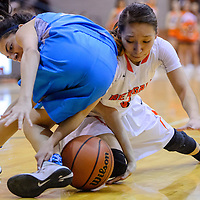 Gallup Bengal Kalisha Kinsel (5) and Cleveland Storm Britney Lovato (12) get tangled as they compete for the ball Saturday at Gallup High School.