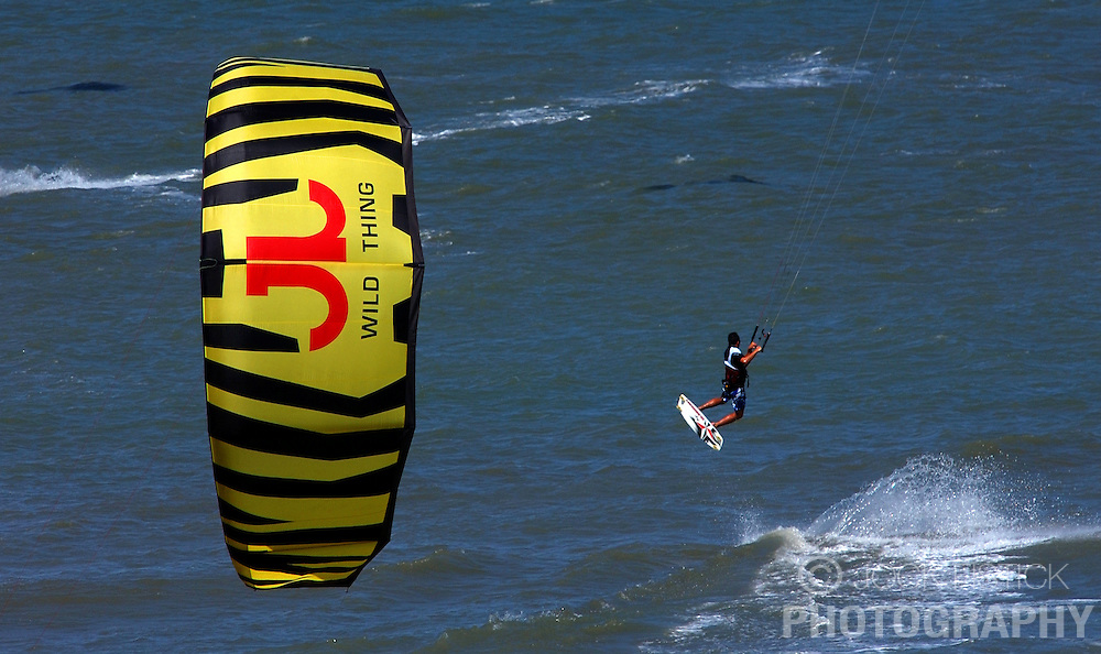 A kitesurfer flys through the air over the waters of the North Sea. (Photo © Jock Fistick)