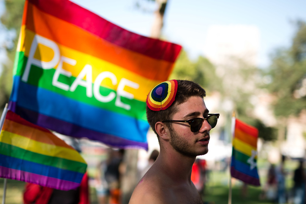 Israelis participate at the annual Gay Pride parade in Jerusalem, Israel on July 30, 2015. Six people were stabbed at the parade after the assailant, an ultra-Orthodox Jewish man identified as Yishai Shlissel, emerged behind the marchers and began stabbing them while screaming. He was arrested by the Israeli police. Shlissel was recently released from prison after serving a term for stabbing several people at a gay pride parade in 2005.