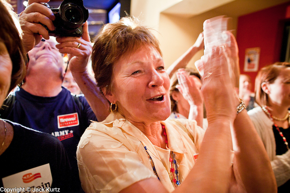 24 AUGUST 2010 -- TUCSON, AZ: Lucille Webb, from Tucson (ALL CQ) cheers for Gov Jan Brewer in Tucson Tuesday night. Gov Brewer made an appearance at Mr. An's Teppan Steak & Sushi in Tucson Tuesday night just as early returns in Arizona's primary elections were starting to come in. Brewer's victory has been credited to her signing SB 1070 and taking a tough stand on illegal immigration and against the Obama administration.   PHOTO BY JACK KURTZ