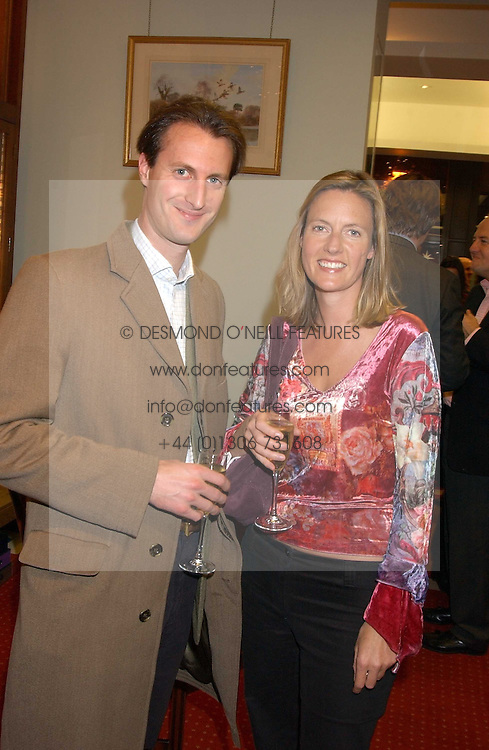 ALAISTER ORCHARD and his sister ALEXANDRA ORCHARD at a drinks party for the Game Conservancy Trust's committee held at Williams & Son, 10 Mount Street, London WlK hosted by Willaim & Lucy Asprey on 6th December 2005.<br /><br />NON EXCLUSIVE - WORLD RIGHTS