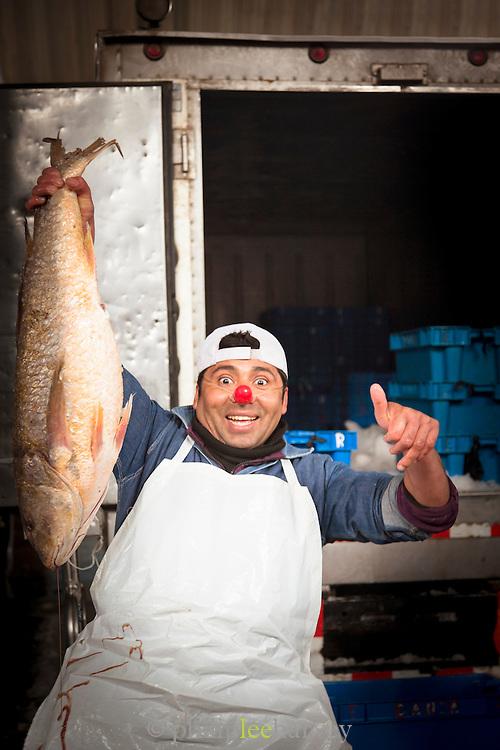 Portrait of Fish monger at the Fish Market in Villa Mar?a del Triunfo district of Lima, Peru, South America