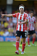 Cedric Soares of Southampton with his bandaged head looks on. Barclays Premier League, Watford v Southampton at Vicarage Road in London on Sunday 23rd August 2015.<br /> pic by John Patrick Fletcher, Andrew Orchard sports photography.