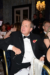 Football manager ALAN CURBISHLEY at Fashion For The Brave at The Dorchester, Park Lane, London on 8th November 2013.