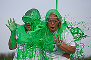 William DeShazer/Staff<br /> Principal Aida Saldivar, left, and assistant principal Tammy Forkey have slime dumped on them at San Carlos Park Elementary as a reward for students reaching their reading goal of 1 million minutes on Monday May 20, 2013.
