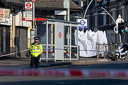© Licensed to London News Pictures. 27/02/2019. London, UK. A police officer at the scene outside Ilford Station, where a 20-year-old man was fatally stabbed last night. A murder investigation has been launched. Photo credit: Rob Pinney/LNP