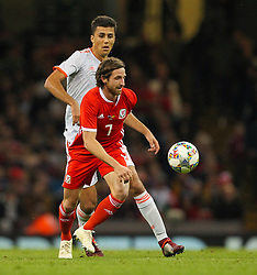 October 11, 2018 - Cardiff City, Walles, United Kingdom - Cardiff, Wales October 11, ..Joe Allen of Wales controls the ball despite the pressure from Rodri of Spain during Exhibition Match between Wales and Spain at Principality stadium, Cardiff City, on 11 Oct  2018. (Credit Image: © Action Foto Sport/NurPhoto via ZUMA Press)