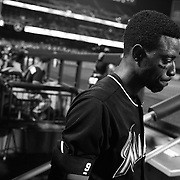 Dee Gordon, MIami Marlins, in the dugout preparing to bat during the New York Mets Vs Miami Marlins MLB regular season baseball game at Citi Field, Queens, New York. USA. 16th September 2015. Photo Tim Clayton