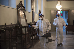 Staff members disinfect Panagia Altinmermer Church, on March 15, 2020, in Istanbul, Turkey. Turkey on Tuesday, confirmed 6 cases of novel coronavirus infection in the country. Photo by Mustafa Alkac/Depo Photos/ABACAPRESS.COM