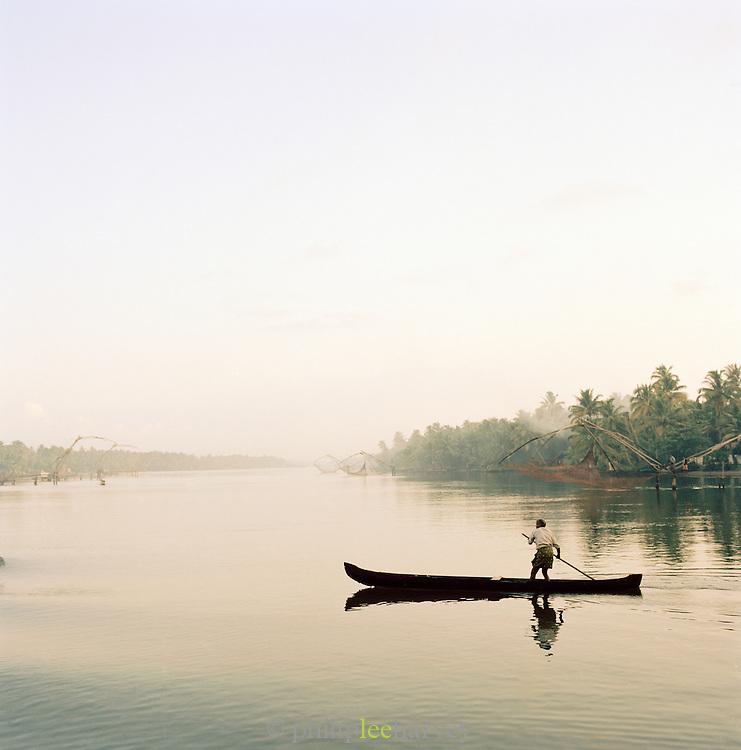 A fisherman on the Kerala backwaters, Kerala, India