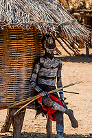 Kara tribe boy with chalk body painting, Omo Valley, Ethiopia.