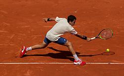 May 30, 2018 - Paris, Ile-de-France, France - Jaume Munar of Spain returns the ball to Novak Djokovic of Serbia during the second round at Roland Garros Grand Slam Tournament - Day 4 on May 30, 2018 in Paris, France. (Credit Image: © Robert Szaniszlo/NurPhoto via ZUMA Press)