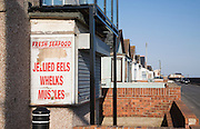 Peeling sign for seafood on Brooklands estate Jaywick, Essex, regarded as the most socially deprived community in England.