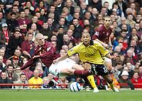 Photo: Ed Godden.<br />Arsenal v Aston Villa. The Barclays Premiership. 01/04/2006. Philippe Senderos (L) challenges Villas Luke Moore.