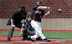 26 April 2014:  batter Mike Hollenbeck in front of Matt Jones and umpire Bret Bruington during an NCAA Division 1 Missouri Valley Conference (MVC) Baseball game between the Southern Illinois Salukis and the Illinois State Redbirds in Duffy Bass Field, Normal IL