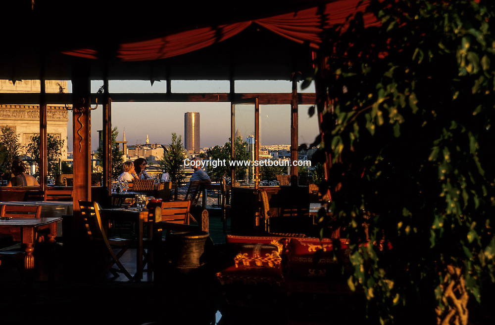 panoramic view on Paris and the sacre coeur from the terrace of the cafe bar, the Golf club  Paris  France