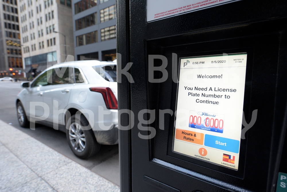 Chicago parking meter sign and pay box station in Chicago, Illinois. Photo by Mark Black