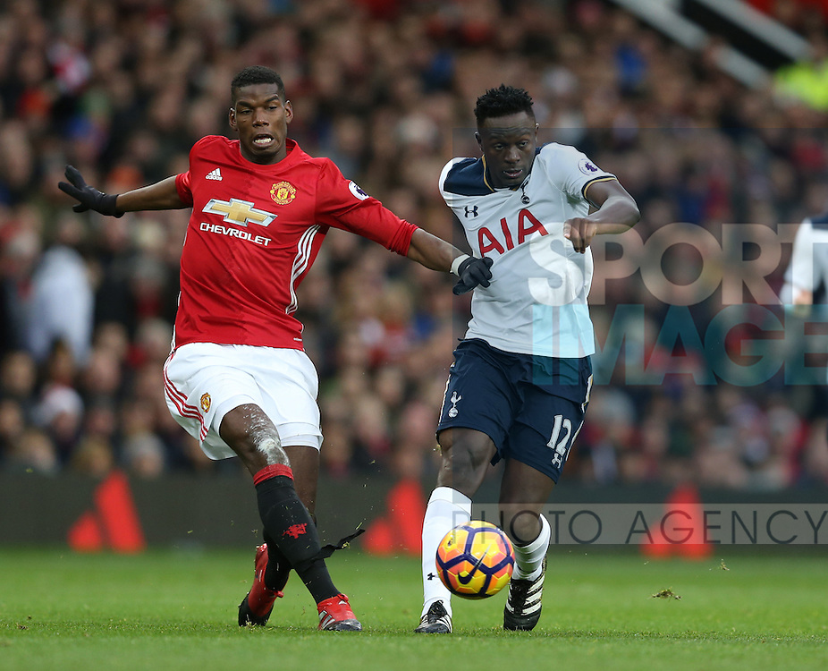 Paul Pogba of Manchester United tussles with Victor Wanyama of Tottenham during the English Premier League match at Old Trafford Stadium, Manchester. Picture date: December 11th, 2016. Pic Simon Bellis/Sportimage