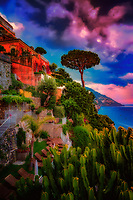 """""""Sunset view from the Hotel California Positano""""…<br /> <br /> After an exhilarating drive along the high cliffs on the Amalfi coast from Sorrento down to Positano, I found myself in sensory overload with its beauty and photogenic appeal.  After circling around the entire village and its cliffside three times on Positano's only street, which was a single lane winding down from the top and back up and over to where I began, I finally found the parking garage by the hotel, about 2/3rds up the facing village in this image.  The climb down the winding road and steep staircases made for quite a workout in the hot late May sun.  Reaching the beach and marina, I forgot about my exhaustion and could not capture enough of Positano's plush beauty; however, the large amount of tourists and bright sun did not allow for ideal conditions.  Walking the length of the beach, I found a very, very steep staircase leading straight up to a large veranda at the Albergo California.  Taking an exhaustive seat on a plush lounge chair with a perfect view to watch the sunset behind the Amalfi Cliffs, I was taken back by a pleasant Italian (Positano) waiter from the hotel offering a towel, ice water, and drinks for the evening.  I expressed that I was not staying at the hotel, but he didn't seem to mind and proceeded to educate me on the culture of this historic resort village.  After a brief rest, I wandered around taking full advantage of Albergo California's 180 degrees of seaside vistas.  Turning southward looking down the Amalfi Coast, the seaside town of Praiano began to appear ominous as storm clouds formed above creating a dramatic view."""