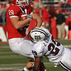 Oct 10, 2009; Piscataway, NJ, USA; Texas Southern safety Jashaad Gaines (29) tackles Rutgers FB Jack Corcoran (19) during first half NCAA college football action between Rutgers and Texas Southern at Rutgers Stadium.
