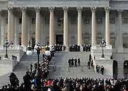 © Licensed to London News Pictures. 03/01/2013. Washington DC, USA .  Senator Mark Kirk walks walks up the stairs to Congress at the Capitol Building, aided by Vice President Joe Biden and applauded by a large crowd in Washington DC today 3rd January 2013. Senator Kirk had suffered a stroke on January 21st 2012, today marks his return return to work after a remarkable recovery. Photo credit : Stephen Simpson/LNP