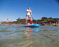 Family having fun with Stand up paddleboard (SUP) at Colwell Bay, Isle of Wight