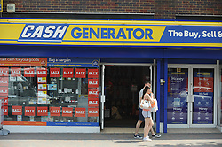 © London News Pictures. 14/07/2013. COPY AVAILABLE BELOW…. Cash Generator on Orpington High Street, Kent. An example of the changing face or the high street. Orpington High street now has 12 charity shops  in one short stretch, with Cancer Research UK having two shops on different sides of the high street almost facing each other.  COPY AVAILABLE HERE:  http://tinyurl.com/nhtxtyd<br /> <br /> Photo credit :Grant Falvey/LNP