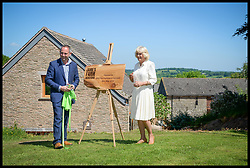 May 30, 2017 - Herefordshire, Herefordshire, United Kingdom - Image ©Licensed to i-Images Picture Agency. 26/05/2017. Herefordshire, United Kingdom. Duchess of Cornwall visit to Herefordshire. ..The Duchess of Cornwall, Patron, Jamie's Farm, unveils a wooden plaque with owner Jamie Feilden, during a visit to the charity's Herefordshire farm at Lower Wernddu Farm, Rowlestone, Longtown, Herefordshire...Picture by  i-Images / Pool (Credit Image: © i-Images via ZUMA Press)