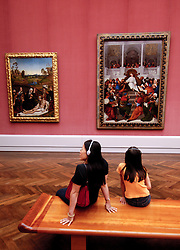 Visitors looking at paintings in famous Gemaldegallerie at Kulturforum in Berlin