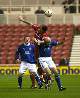 Photo. Glyn Thomas.<br /> Middlesbrough v Everton. Carling Cup Round 4.<br /> Riverside Stadium, Middlesbrough. 03/12/2003.<br /> Boro's Franck Queudrue (C) leaps over Lee Carsley (R) and Wayne Rooney.
