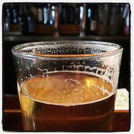 2018 SEPTEMBER 03 - Beer in a pint glass at a bar in Seattle, WA, USA. Taken/edited with Instagram App for iPhone. By Richard Walker