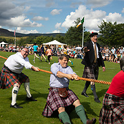 Highland Games, 3rd of August 2019, Newtonmore, Scotland, United Kingdom. Traditional tug o'war. The Highland Games is a traditional annual event where competitors compete as strong men, runners, dancers, pipers and at tug-of-war. The games go back centuries and are happening through-out the summer across Scotland. The games are both an important event locally and a global tourist attraction.