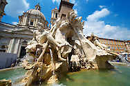 Fountain of the Four Rivers by Bellinio, designed to carry the Egyptian obalisque brough from the Circus Maximus. The 4 figures represent the Nile,  Ganges, Danube amd Rio de la plata. Plazza Novona,  Rome .<br /> <br /> Visit our ITALY HISTORIC PLACES PHOTO COLLECTION for more   photos of Italy to download or buy as prints https://funkystock.photoshelter.com/gallery-collection/2b-Pictures-Images-of-Italy-Photos-of-Italian-Historic-Landmark-Sites/C0000qxA2zGFjd_k<br /> .<br /> <br /> Visit our EARLY MODERN ERA HISTORICAL PLACES PHOTO COLLECTIONS for more photos to buy as wall art prints https://funkystock.photoshelter.com/gallery-collection/Modern-Era-Historic-Places-Art-Artefact-Antiquities-Picture-Images-of/C00002pOjgcLacqI