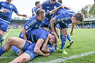 The FC Halifax Town players celebrate taking the lead having scored the first goal in the game and lead the two legged tie 2-1 in the first half of extra time during the Vanarama National League North match between FC Halifax Town and Salford City at the Shay, Halifax, United Kingdom on 7 May 2017. Photo by Mark P Doherty.