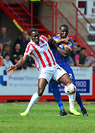 Mathieu Manset battle for the ball with Jermaine Grandison during the Sky Bet League 2 match between Cheltenham Town and Shrewsbury Town at Whaddon Road, Cheltenham, England on 25 April 2015. Photo by Alan Franklin.