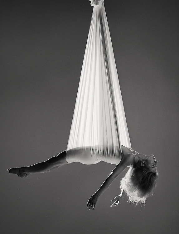 Hanging.tif Ray Massey is an established, award winning, UK professional  photographer, shooting creative advertising and editorial images from his stunning studio in a converted church in Camden Town, London NW1. Ray Massey specialises in drinks and liquids, still life and hands, product, gymnastics, special effects (sfx) and location photography. He is particularly known for dynamic high speed action shots of pours, bubbles, splashes and explosions in beers, champagnes, sodas, cocktails and beverages of all descriptions, as well as perfumes, paint, ink, water – even ice! Ray Massey works throughout the world with advertising agencies, designers, design groups, PR companies and directly with clients. He regularly manages the entire creative process, including post-production composition, manipulation and retouching, working with his team of retouchers to produce final images ready for publication.