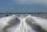 Wake of a speedboat headed for Venice from Marco Polo airport. The wooden posts mark the route the boats must take.