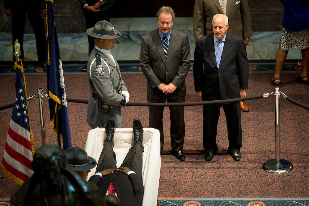 Former South Carolina Gov. Jim Hodges (right) views the body of Sen. Clementa Pinckney as he lay in state at the South Carolina State House on June 24, 2015 in Columbia, South Carolina. On June 17, 2015, nine people were shot and killed inside Emanuel African Methodist Episcopal Church in Charleston, South Carolina, where Pinckney was the pastor, during Bible study. A suspect, Dylann Roof, 21, was arrested in connection with the shootings. Photo by Kevin Liles/UPI