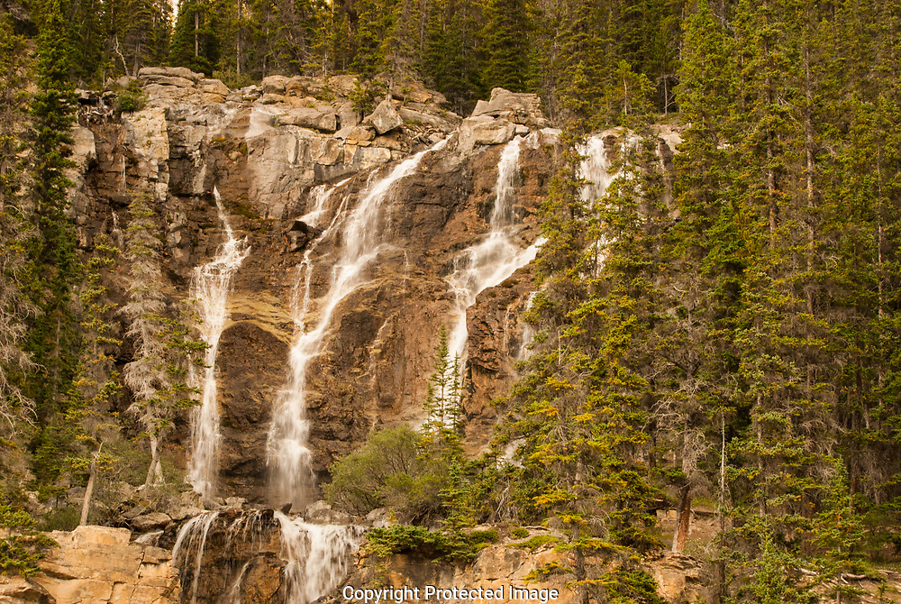 Bridal Veil Falls is steep and deep as it cascades over the rocks in Alberta, Canada. It can be seen from the highway.