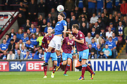 Scunthorpe United midfielder Josh Morris (11) and Portsmouth midfielder Matthew Kennedy (11)  during the EFL Sky Bet League 1 match between Scunthorpe United and Portsmouth at Glanford Park, Scunthorpe, England on 23 September 2017. Photo by Ian Lyall.