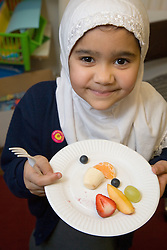 Pupil having a healthy school dinner at the Nottingham Islamia school,