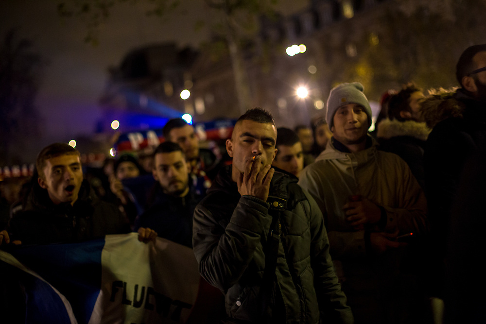 Paris, France.  November 13, 2016.  Hundreds of PSG  football club supporters march and chant in Place de la Republique (Republic Square) to pay tribute to the more than 130 victims of the  Islamic State (ISIS) terrorist attacks which occurred one year before.