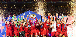 June 2, 2019 - Madrid, Spain - 190602 Jordan Henderson of Liverpool raises the throphy in front of team mates at the medal ceremony after the UEFA Champions League final between Tottenham and Liverpool on June 2, 2019 in Madrid..Photo: Petter Arvidson / BILDBYRÃ…N / kod PA / 92302 (Credit Image: © Petter Arvidson/Bildbyran via ZUMA Press)