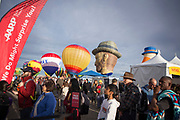 Spectators watch as balloons inflate at at the AARP Block Party at the Albuquerque International Balloon Fiesta in Albuquerque New Mexico USA on Oct. 7th, 2018.